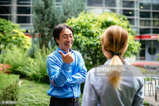 Business people in Japan, talking and smiling