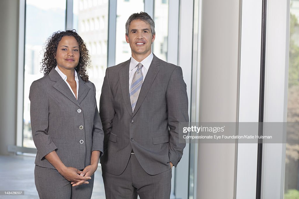 Business people in lobby, smiling : Stock Photo