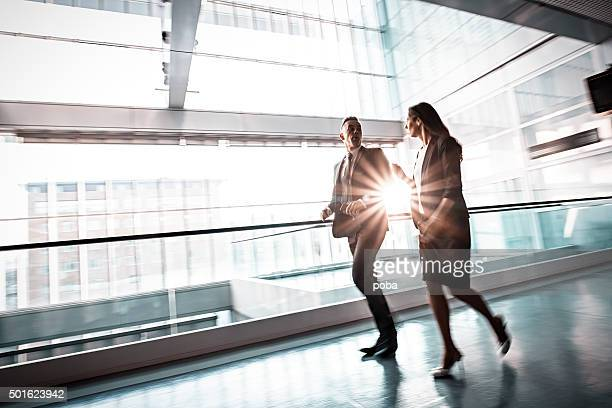 Business people in lobby walking