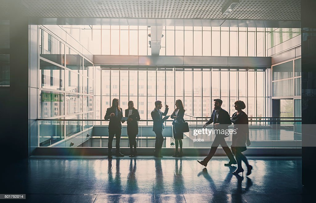 Business people in lobby walking : Stock Photo