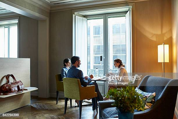 Business people in meeting at hotel room