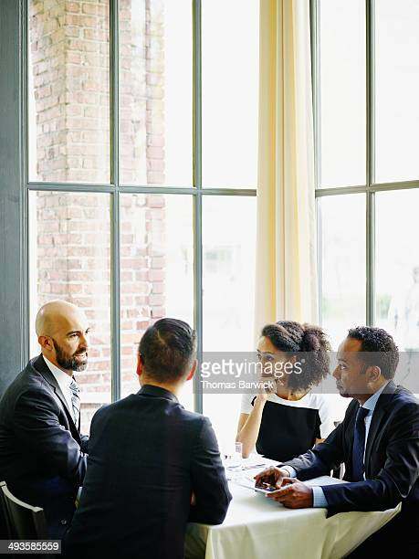 Business people in meeting at table in restaurant