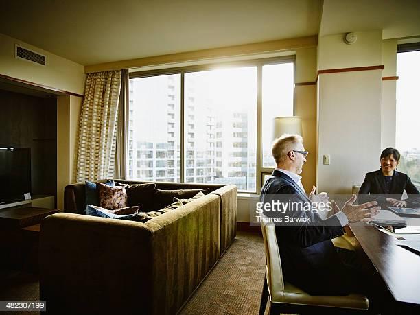 Business people in meeting in hotel suite
