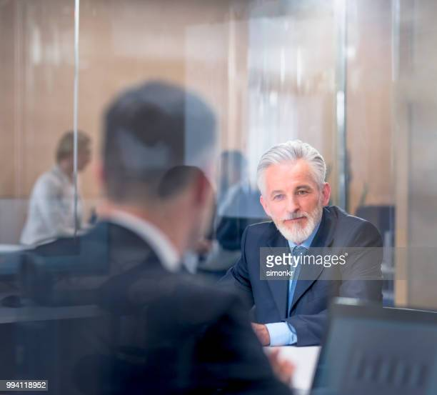 business people in meeting room - blue blazer stock pictures, royalty-free photos & images