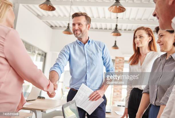 business people in office shaking hands - job interview stock pictures, royalty-free photos & images