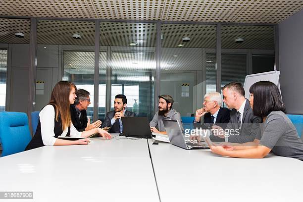 Business people in office talking about their problems,using laptops