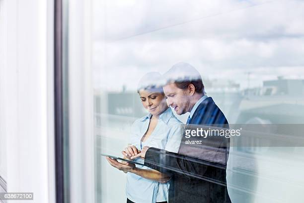 business people in office using digital tablet - discussion stock photos and pictures