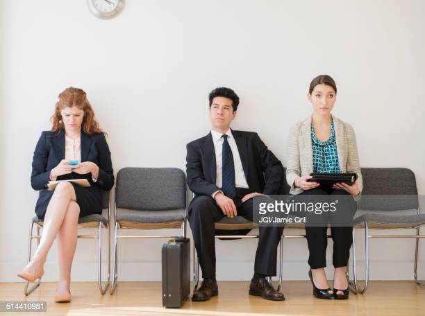 Business people in office waiting room