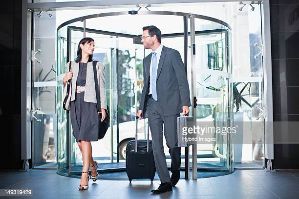 Business people in revolving door