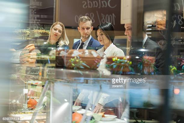 Business people in self service restaurant