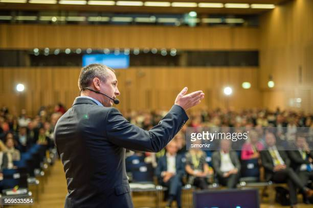 business people in seminar at auditorium - speech stock pictures, royalty-free photos & images