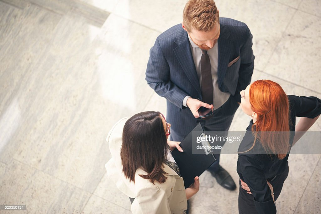 Business people in the lobby talking overhead shot : Stock Photo