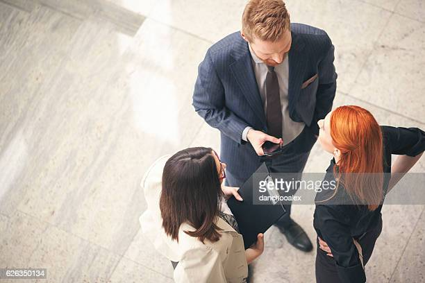 business people in the lobby talking overhead shot - 人脈作り ストックフォトと画像
