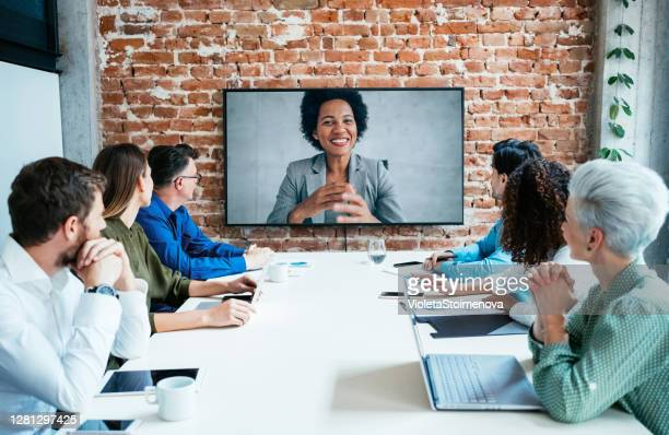 business people in video conference. - television stock pictures, royalty-free photos & images