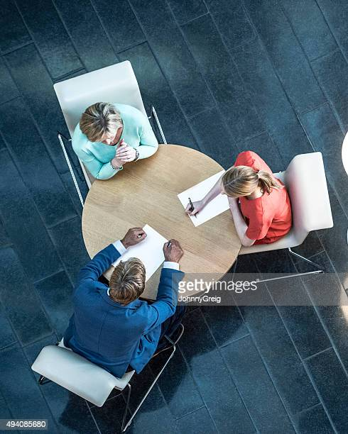 Business people in work meeting, overhead view