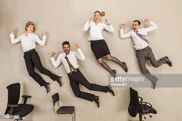 Business people jumping in office