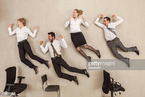 business people jumping in office - human mouth stock pictures, royalty-free photos & images