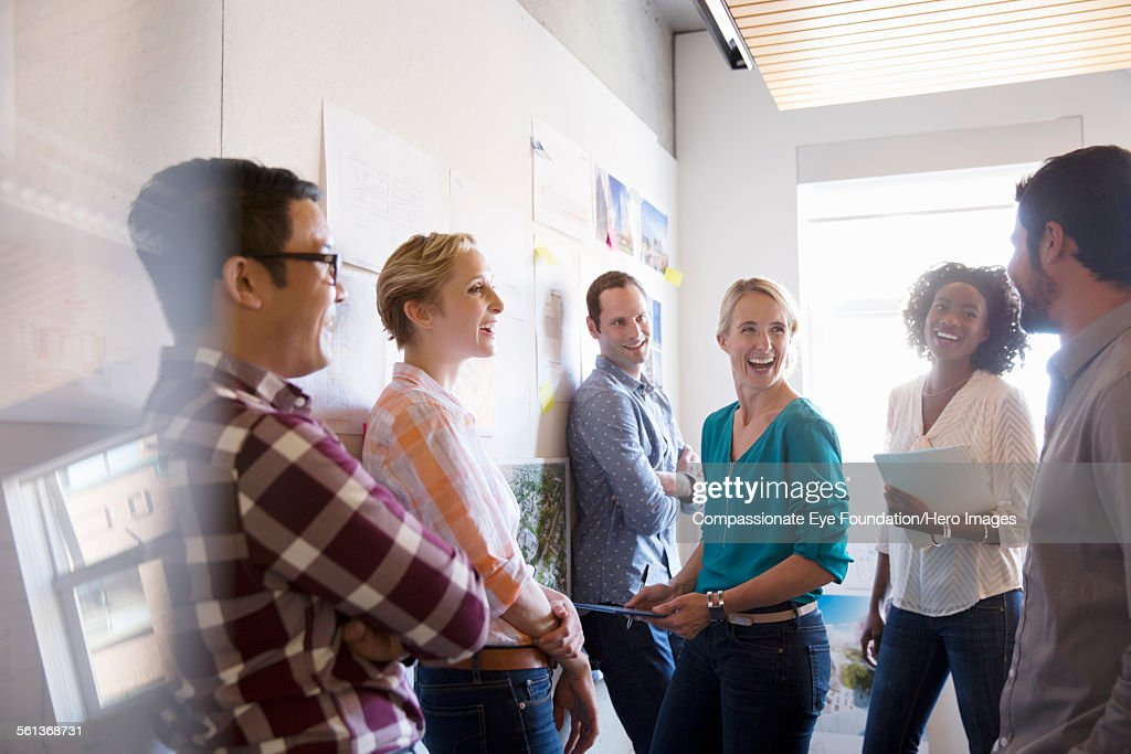 Business people laughing in meeting : Stock Photo