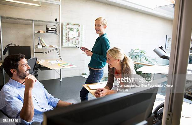 Business people laughing in modern office