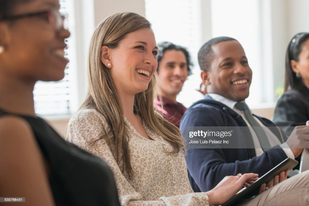Business people laughing in presentation in office : Foto stock
