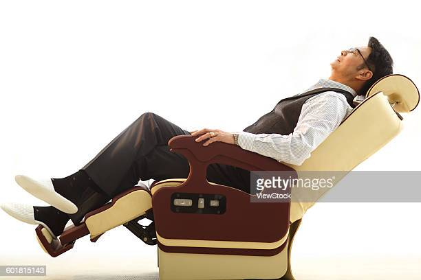 Business people lean on the chair