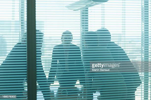 Business people leaning on table in meeting
