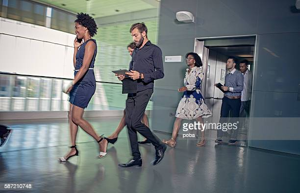 Business people leaving elevator