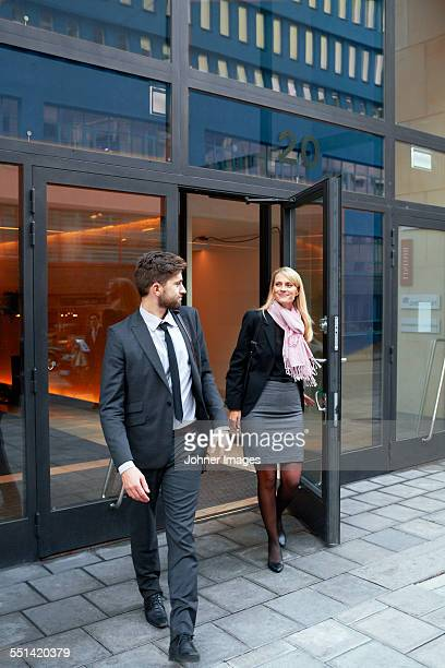 Business people leaving office building