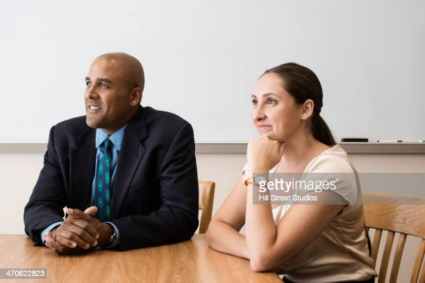 business people listening in meeting - caldwell idaho foto e immagini stock