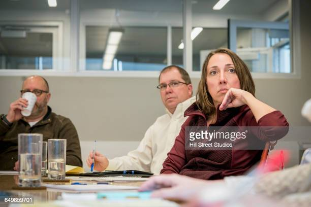 Business people listening in office meeting