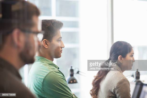 Business people listening in office