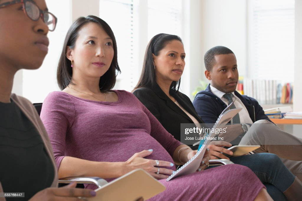 Business people listening in presentation in office : Stock Photo