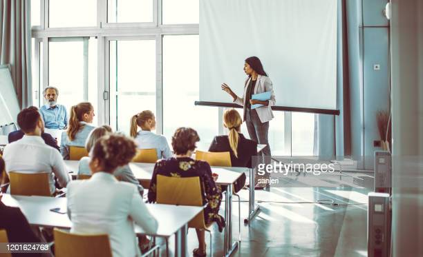 business people listening to the presenter at the conference - candidate stock pictures, royalty-free photos & images
