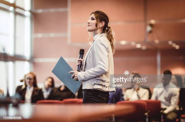 business people listening to the speaker at a conference - press conference stock pictures, royalty-free photos & images
