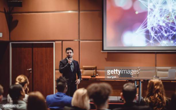 business people listening to the speaker at a conference - presenter stock pictures, royalty-free photos & images