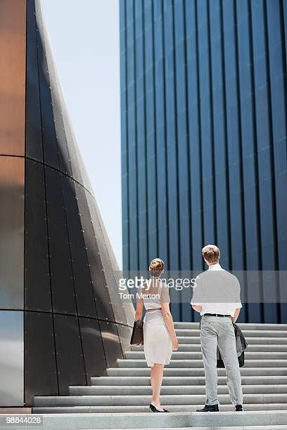 Business people looking at building