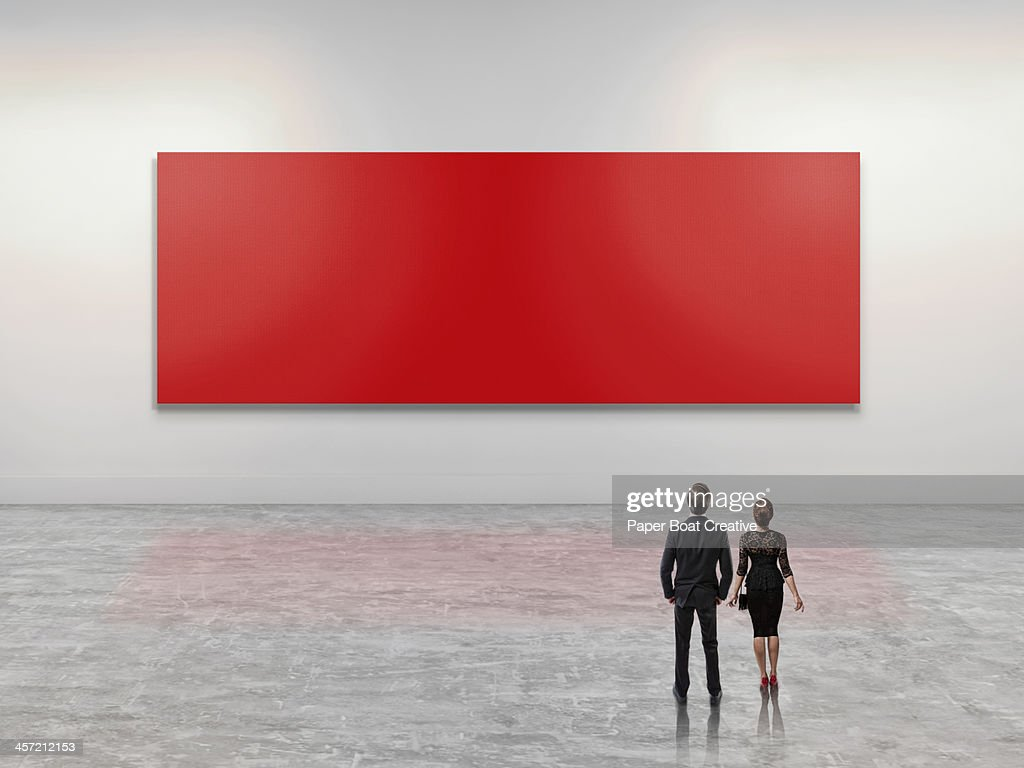Business people looking at giant red art canvas : ストックフォト