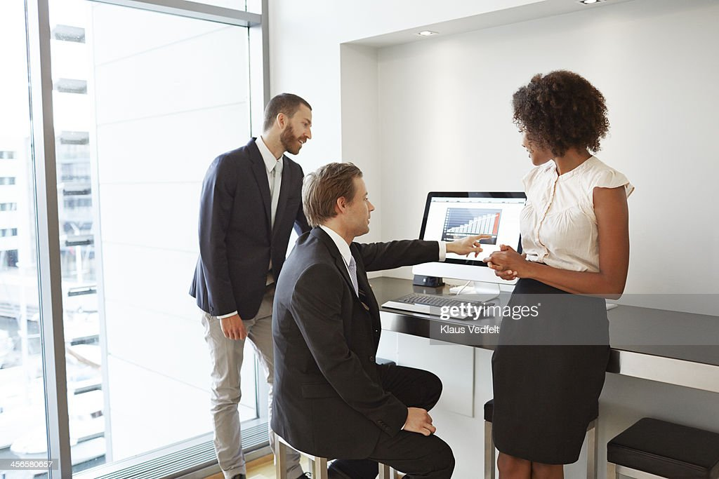 Business people looking at graph : Stock Photo