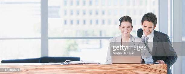business people looking at laptop in office - full suit stock pictures, royalty-free photos & images