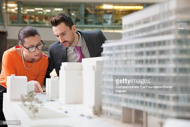 Business people looking at model building