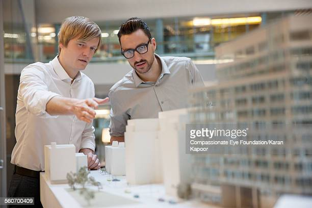 business people looking at model building - architectural model stock pictures, royalty-free photos & images