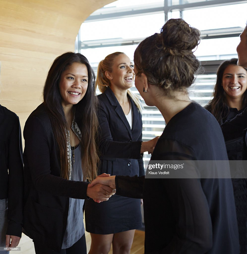 Business people making handshakes before meeting : Stock Photo