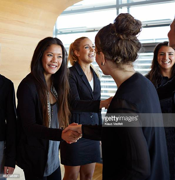 Business people making handshakes before meeting