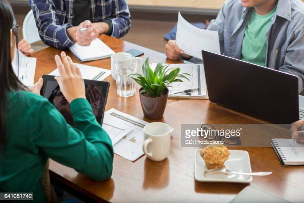 Business people meet in conference room to discuss project