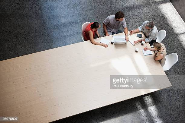 business people meeting at conference table - overhead view stock pictures, royalty-free photos & images