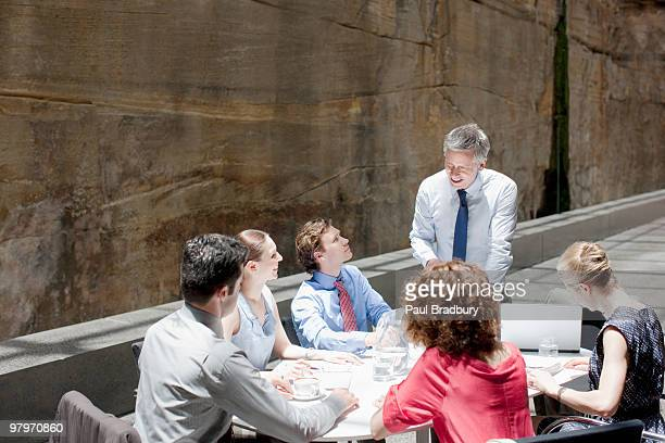 business people meeting at conference table - persuasion stock pictures, royalty-free photos & images