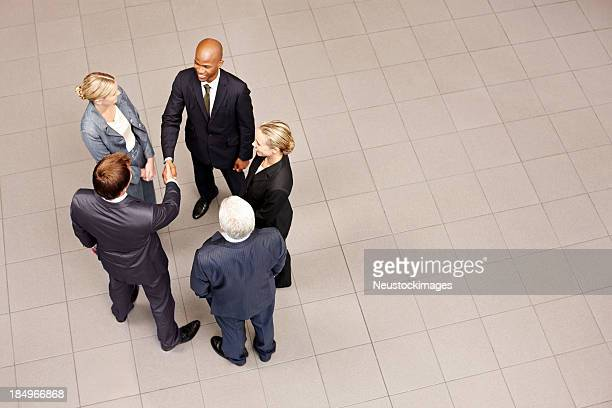 Business People Meeting in a Lobby