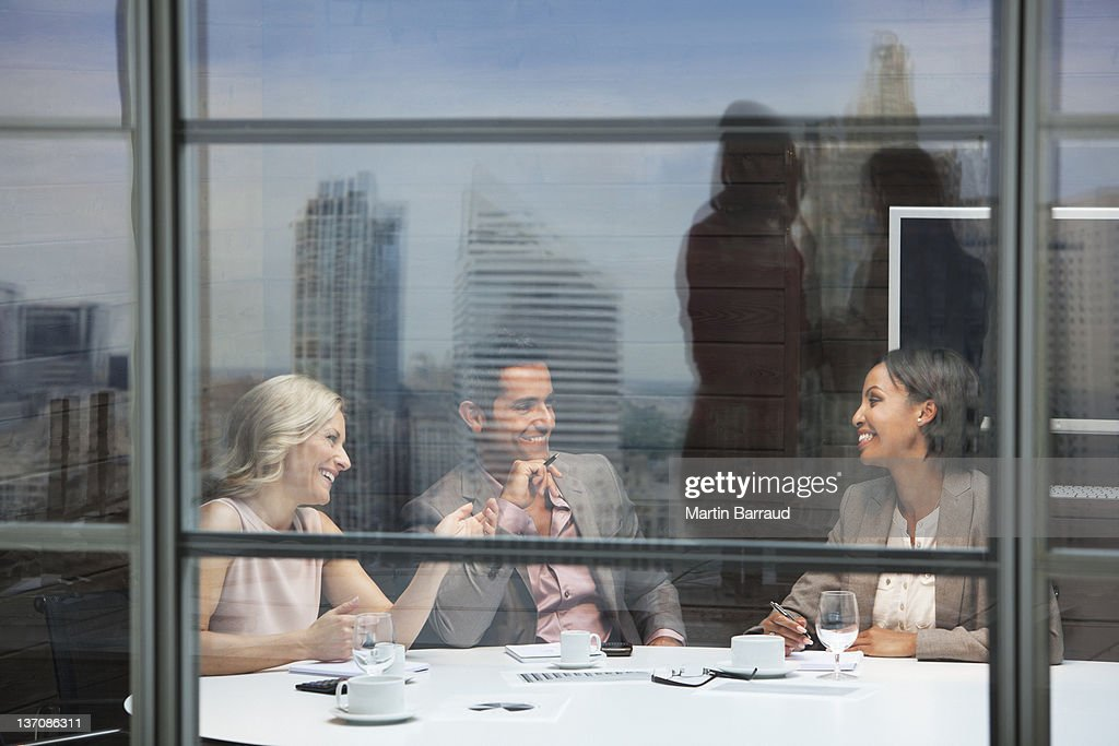 Business people meeting in conference room : Bildbanksbilder