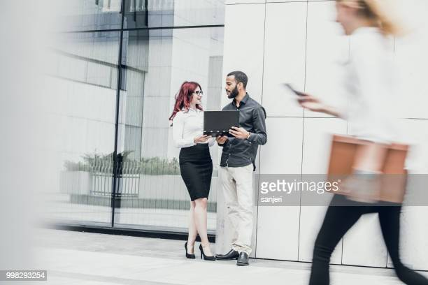 Business People Meeting In Front Of Building