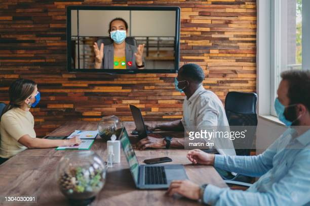 business people meeting on video call in the office during covid-19 pandemic - interview event stock pictures, royalty-free photos & images